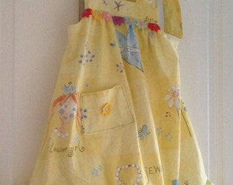 Girl's dress with frill edging