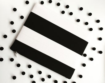 Black and white striped clutch bag