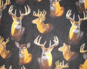 Fleece, deer heads on Black, Baums Textile