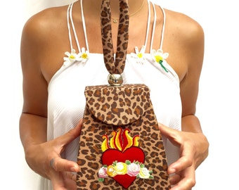 Leopard print evening bag with embroidered sacred heart