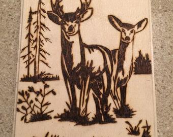 Buck and doe woodburnig