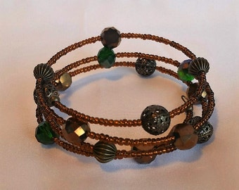 Gold and Emerald Spiral Bracelet