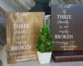 A strand of three cords wood sign. Wedding sign. Wedding decor. Strand of three cords wood sign. Wedding gift. Ecclesiastes 4:9-12.