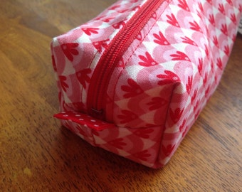 Pink & red pencil case with polka dot lining, box style