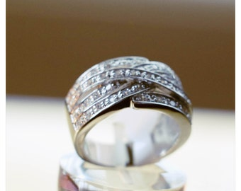 Stunning broad band cross over ring with AAA grade cz