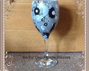 Black circles decoupage wine glass