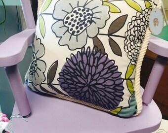 Purple flower decorative pillow, neutral trim