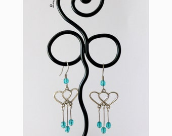 Earrings turquoise blue intertwined hearts