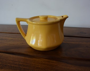 1 yellow teapot art decor stamped Revol