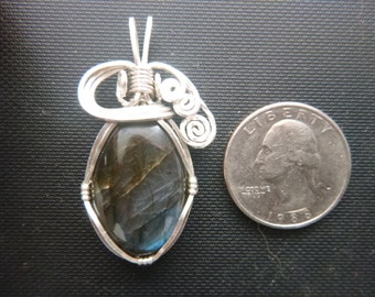 oval labradorite pendant wrapped in silver