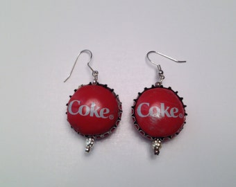 Handmade Coke bottle cap earrings.
