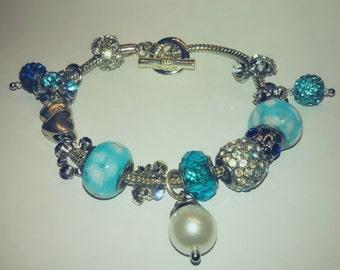 Glistening blue charm bracelet