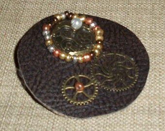 Steampunk inspired hair barrette with swirly gears