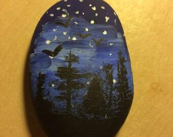 Midnight painted pebble