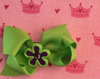 Neon flower charms on bows
