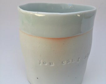 """ceramic porcelain poem cup #9  """"you can't stop being who you are/ it just leaks out"""""""