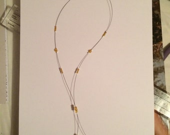 Gold coloured beaded statement necklace