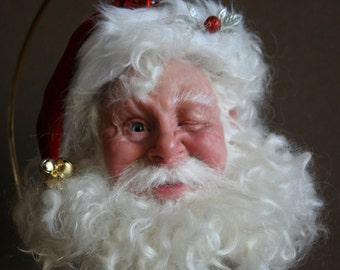 Winking Santa  Christmas ornament original sculpted and deigned by Sue Menz