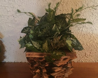 Handmade wooden basket with artificial flowers