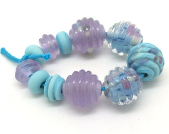 Lamp work bead mix in lilac and turquoise. Handmade SRA glass beads by Josephine Wadman