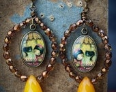 Sleep tight - Jewelry designed for the cat lover. This original pair of earrings by Danita depicts the lovely relationship between cats.