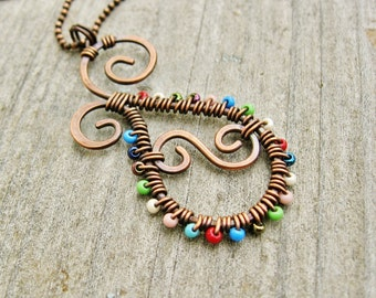 Seed Bead Wire Wrapped Paisley Pendant Necklace of antiqued copper and multi-color glass seed beads