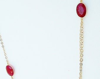red quartz station and gold chain necklace