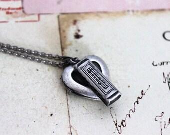 harmonica. heart locket necklace. in silver ox jewelry