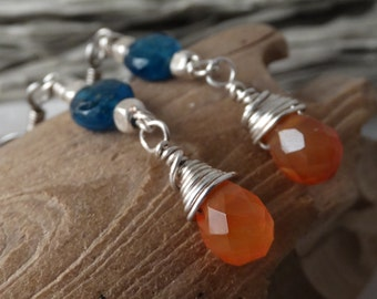 Blue kyanite, faceted teardrop carnelian, and silver beaded and wire wrapped earrings.
