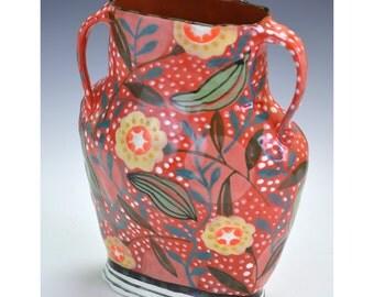 Red vase with star flower, stipple pattern.