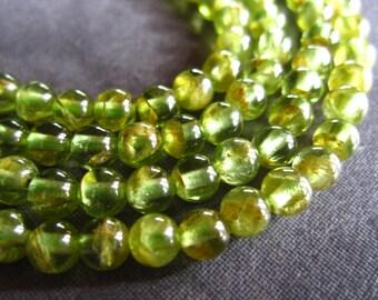 7 1/2 inch strand of natural, genuine Peridot semiprecious gemstones - rounds - 4mm