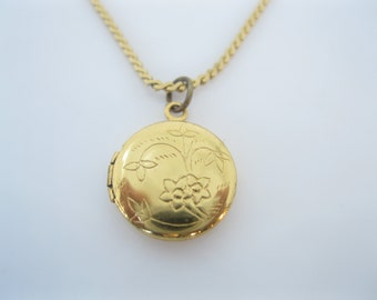 Vintage tiny gold locket
