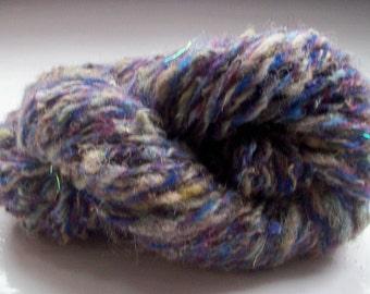 Handspun art yarn, wool, curls, Angelina sparkle, purple by SpinningStreak