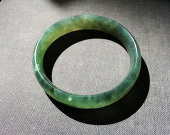 Vintage genuine nephrite jade jadeite bangle bracelet in moss green color. Gemstone bangle, ethnic jewelry, statement bracelet