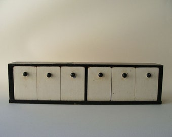 vintage wooden black and white shelf with drawers that tip out