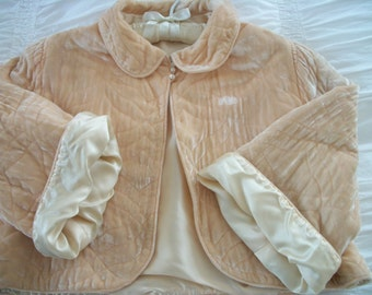 1940s quilted panne velvet and satin bed jacket, little rhinestone buttons, cozy elegant plush warmth, warm peachy flesh color, satin lined