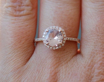 Rose gold diamond ring engagement ring with 1.32ct round white sapphire. Diamond halo rings