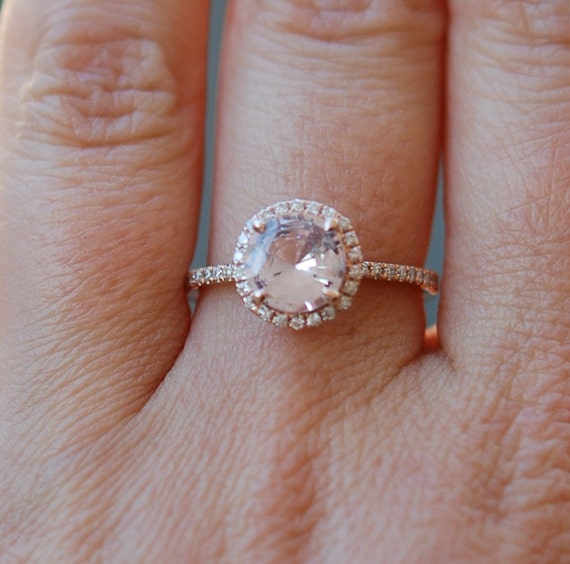 Rose gold diamond ring engagement ring with 1.99ct round peach sapphire. Diamond halo rings