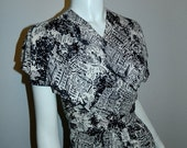 1/2 off Sale / vintage 1950s dress / PARIS streets novelty print / black and white / overlap front XS