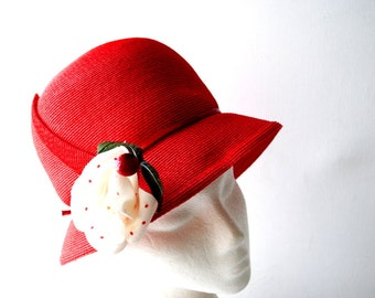 Sweet  blossom vintage 80s lopstick red straw, cloche hat with a white  and red polka dot  flower.Made by Frank Olive.  Size 21.
