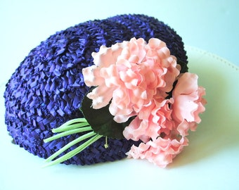 Retro vintage 40s deep purple  , woven straw  with  raffia fascinator hat with a pink flowers of the left side and two pins from the back.