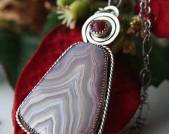 SALE oOo ruby, laguna lace agate and sterling silver metalwork pendant necklace