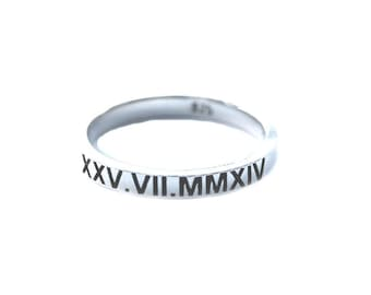 Roman numeral ring sterling silver with the roman numerals of your choice. The band is 3mm wide and 1.8mm thick  or approx 1/8th wide