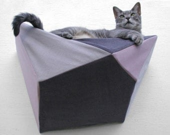 Cat shelf wall bed in pale mauve, grey and charcoal