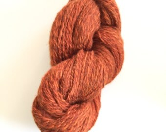 Handspun silk wool blend yarn plyed with shades of orange.