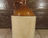 Large old stoneware whiskey jug- 2 toned- brown and beige- solid, weighty, in good vintage condition, great home decor inside or out