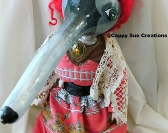 Red hair surreal long billed beast doll steam punk because trains