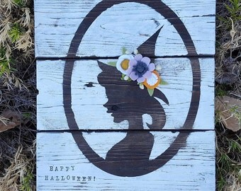 Distressed witch sign with felt flowers
