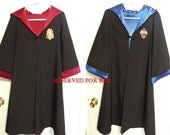 Group listing of one Gryffindor robe, size 6/8 and one Ravenclaw robe, size 6/8