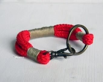 Cotton bracelet with brass ring. Red bracelet.